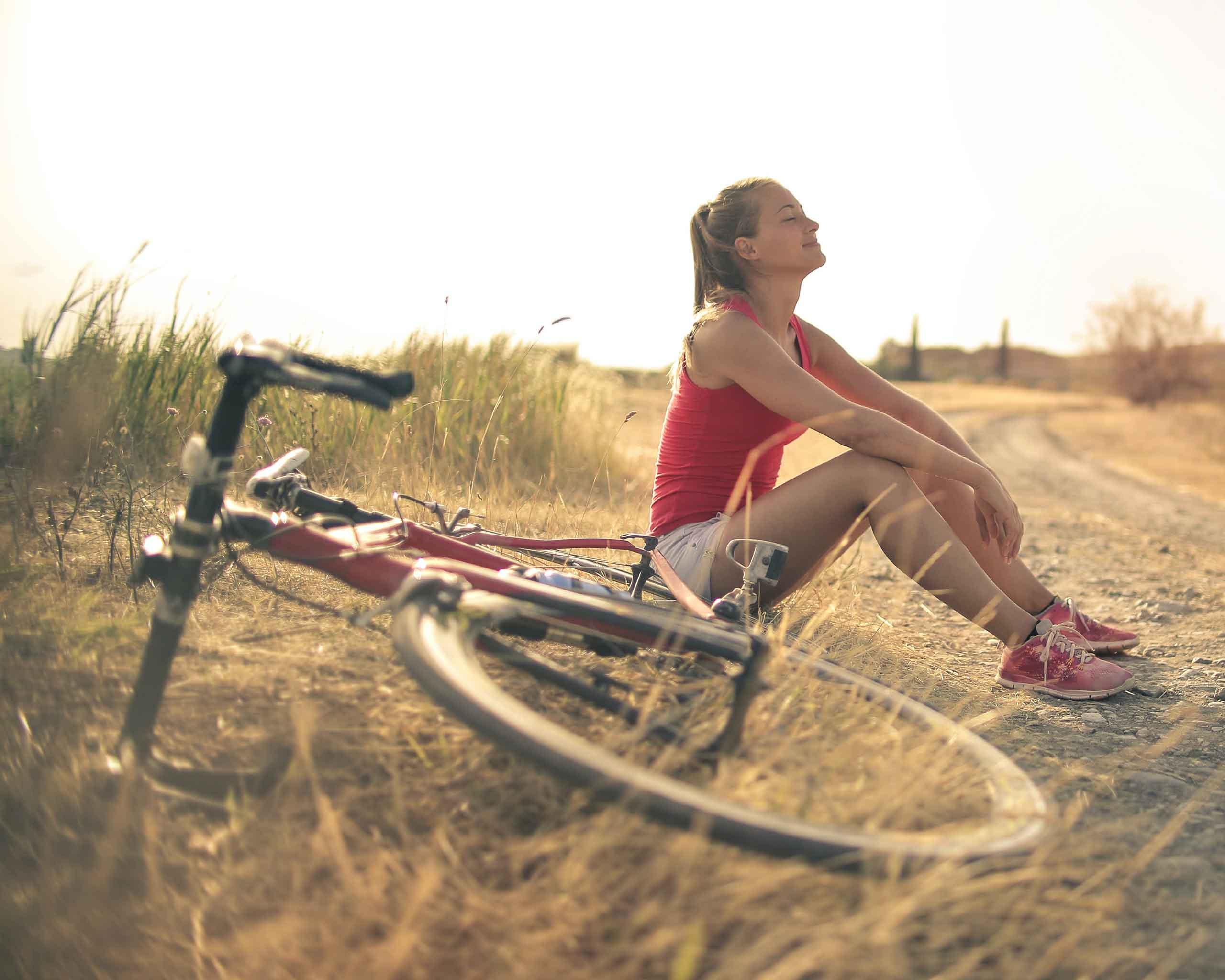 woman taking break bike ride